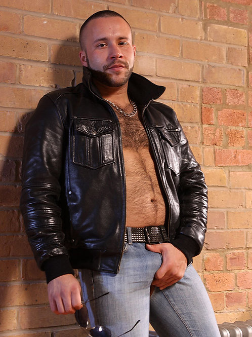 Biker Holding his Ample Package