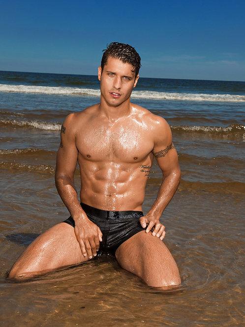 Cody Calafiore Kneeling in the Surf