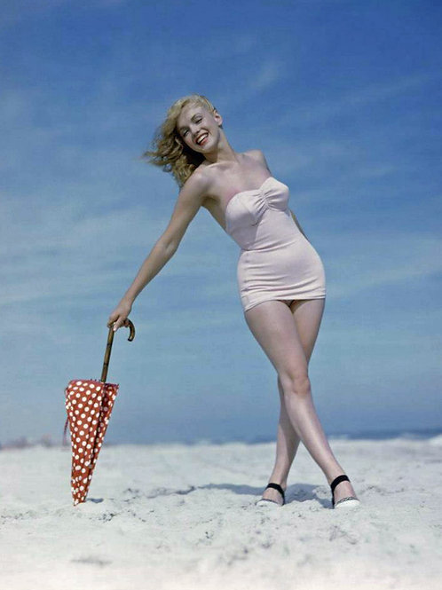 Marilyn Monroe on the Beach with an Umbrella in 1949