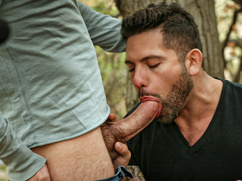 Bearded Man Servicing Cock in the Woods