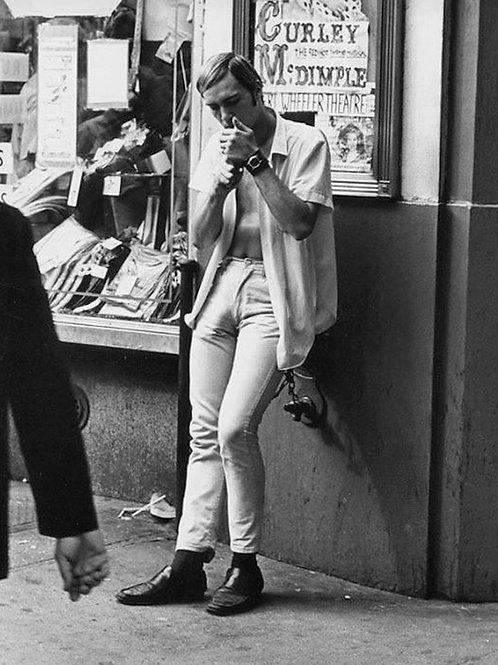Vintage Bulging Guy Lighting his Cigarette