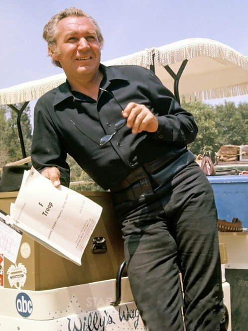 Forrest Tucker Holding a Script by a Boat