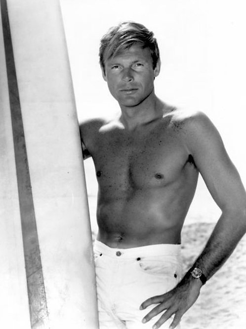 Adam West in the 1960s with a Surfboard