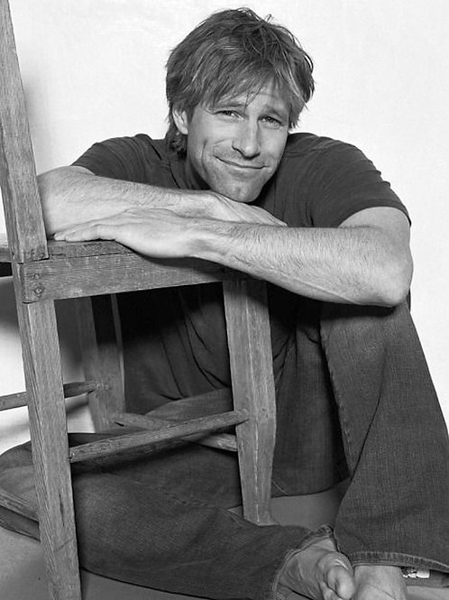 Aaron Eckhart Posing with a Chair