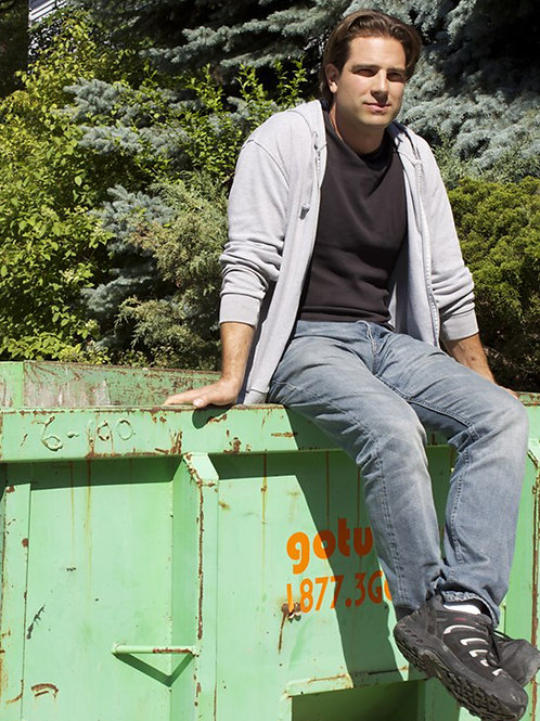Scott McGillivray Sitting on a Dumpster