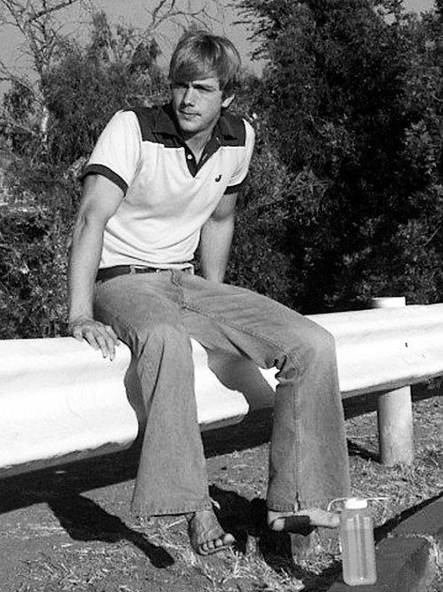 Steve Sandvoss Sitting on a Guardrail