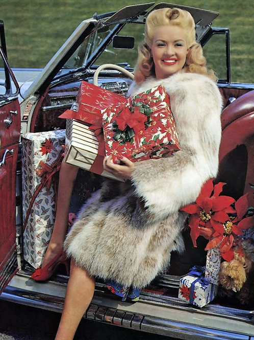 Betty Grabel in Fur Holding Her Holiday Presents