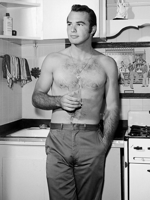 Shirtless Young Burt Reynolds a his Kitchen