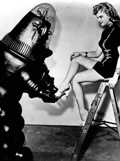Anne Francis Getting Help with Her Shoe From Robbie The Robot
