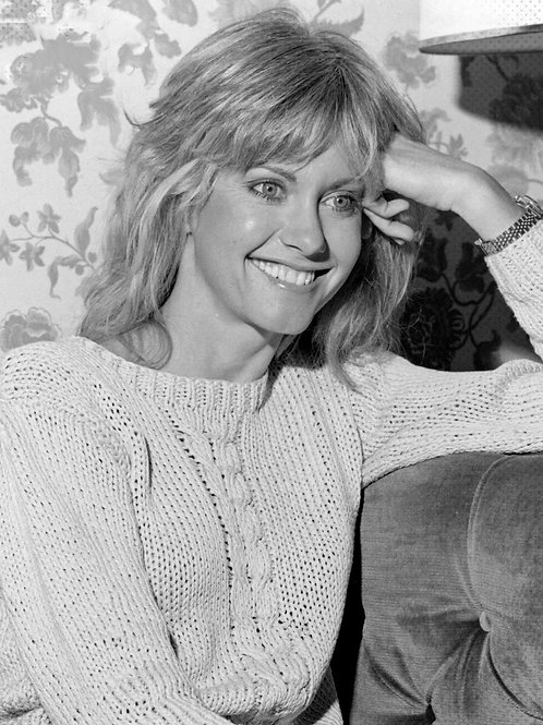 Olivia Newton-John Looking Cute Wearing a Knitted Sweater