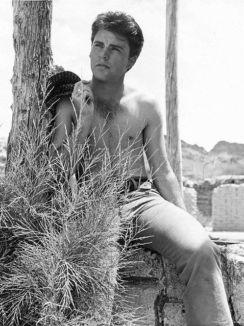 Shirtless Ricky Nelson by a Tree