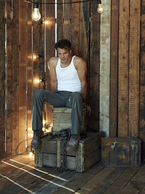 Timothy Olyphant Sitting on an Old Crate
