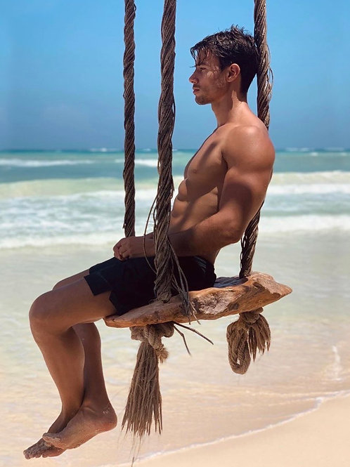 Ezequiel Carballo on a Beach Swing
