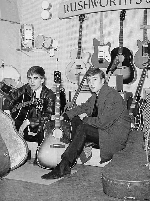 George Harrison & John Lennon with their Gibson Guitars in 1962