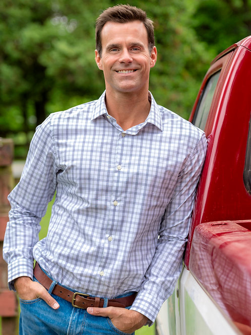 Cameron Mathison Leaning on a Pickup