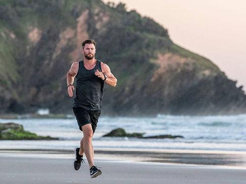 Chris Hemsworth Running on a Beach