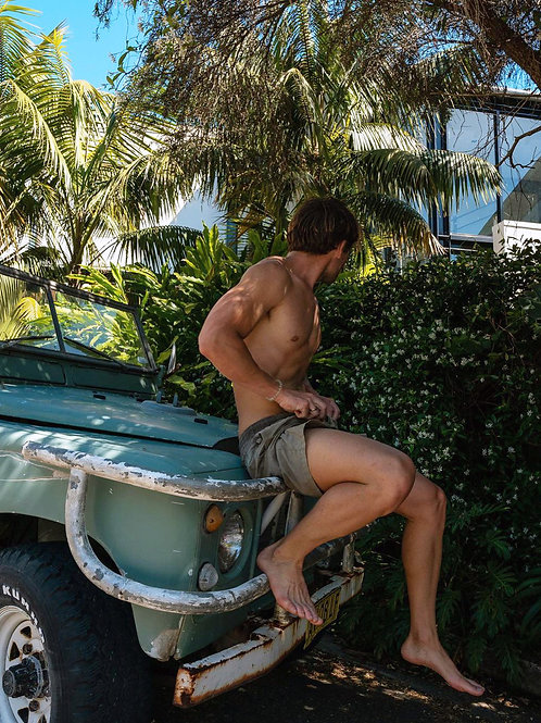 Leaning on an Old Scout SUV