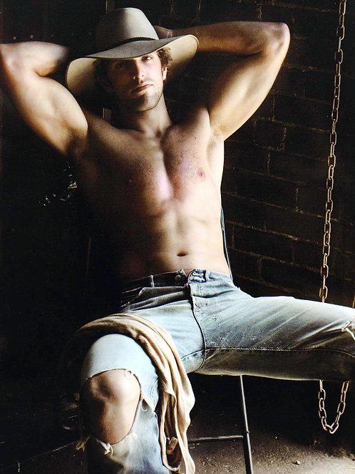 Cowboy Sitting Wearing Torn Jeans
