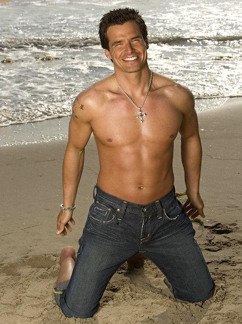 Antonio Sabato Jr. Kneeling on a Beach