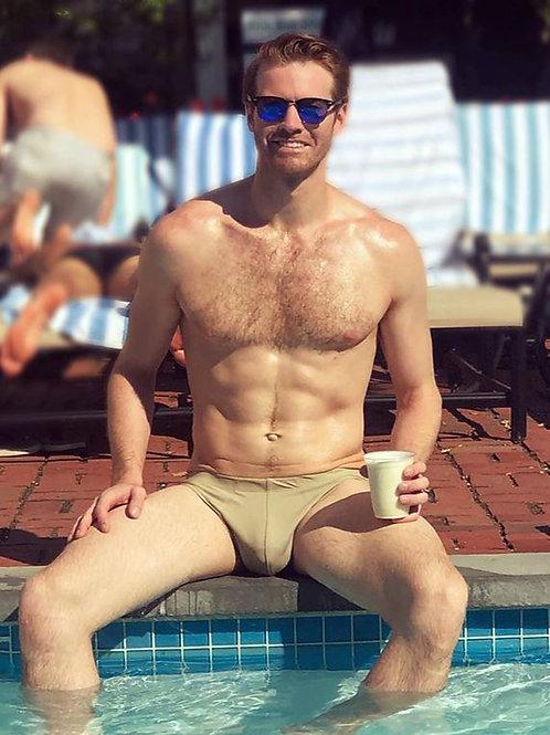 Hunk Enjoying his Coffee by the Pool