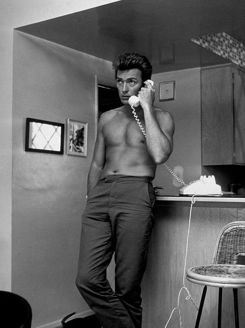 Shirtless Clint Eastwood on a Phone