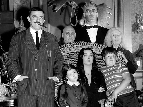Cast of The Addams Family Gathered Together in the Parlor