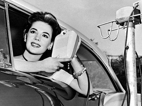 Natalie Wood displays a drive in movie speaker in1957