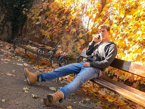 Blonde Stud Alone on a Park Bench