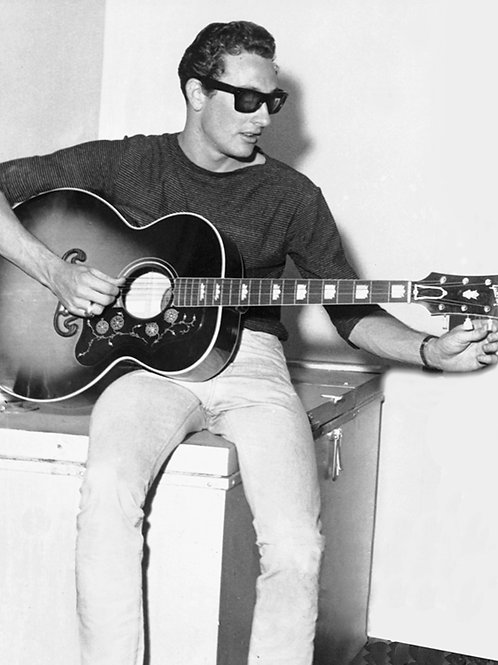 Buddy Holly Adusting his Acustic Guitar