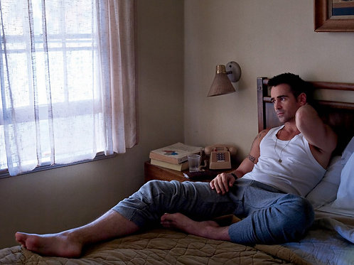 Colin Farrell Laying on a Bed