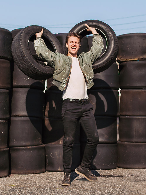 Ansel Elgort Tossing Tires