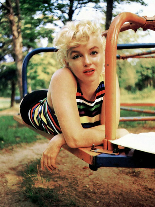 Marilyn Monroe on the Playground merry-go-round in 1955
