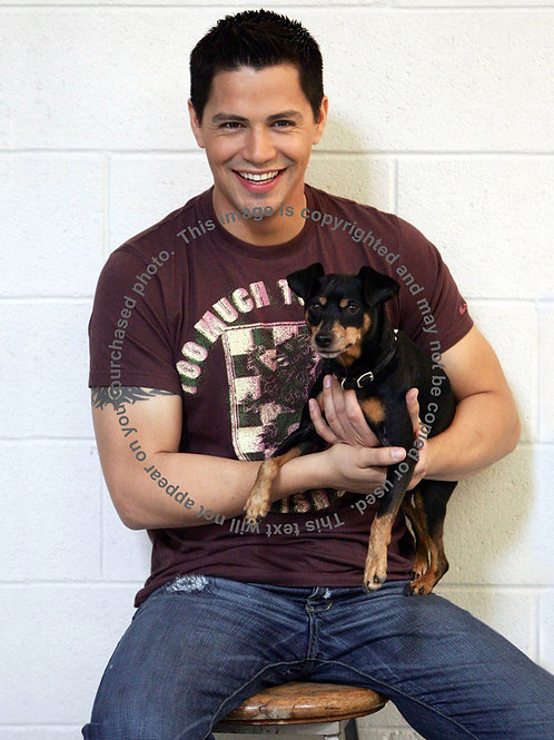 Handsome Jay Hernandez Holding a Puppy