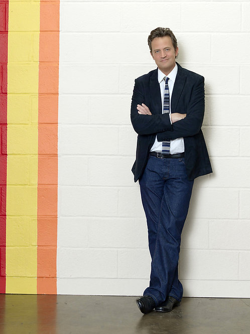 Matthew Perry in a Suite Jacket & Jeans with his Arms Folded