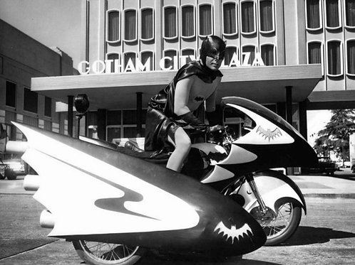 Adam West Sitting on the Batcycle in Front of Gotham City Plaza