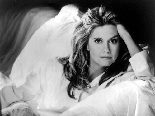Olivia Newton-John Laying on a Bed Looking Very Sexy