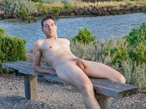 Nude Dude Laying on a Rough Bench