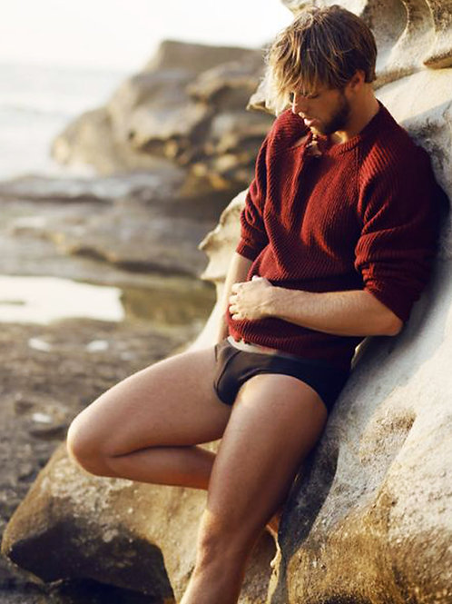 Leaning on a Beach Boulder