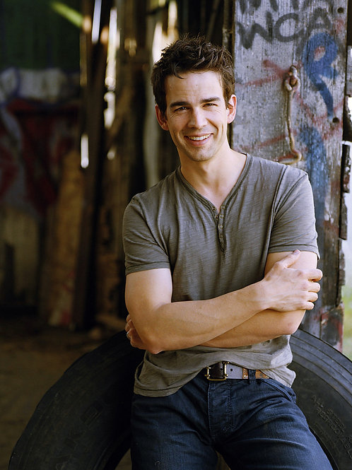 Christopher Gorham Against a Tire