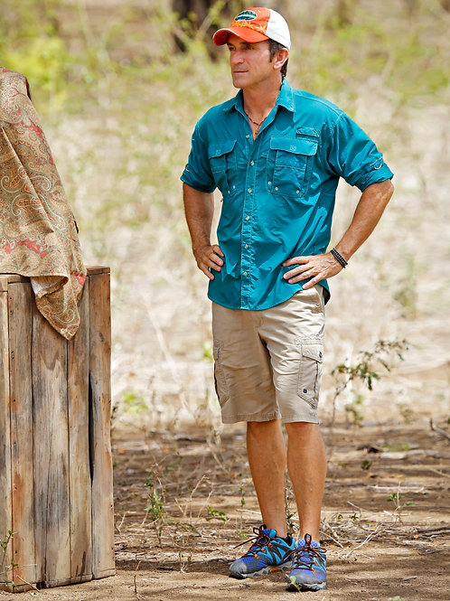 Jeff Probst Wearing Shorts & a Teal Shirt