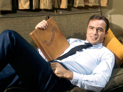 Burt Reynolds on a couch in his TV show Hawk in 1966