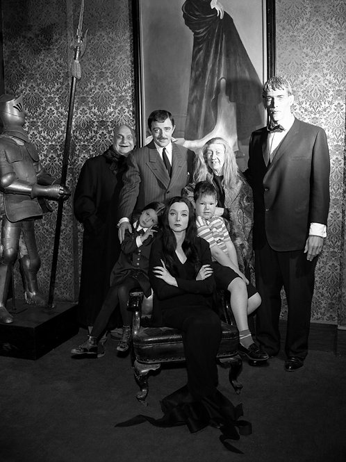 Cast of the Addams Family Posing Beside a Knight
