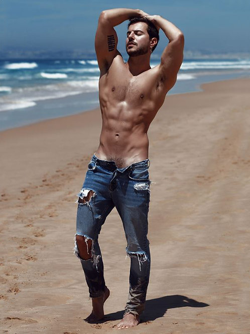 On the Beach in Tattered Jeans