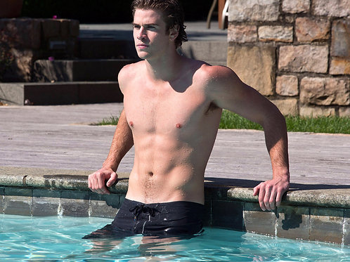 Liam Hemsworth Relaxing in a Pool