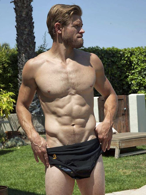 Nude Trevor Donovan Holding Up his Swimsuit