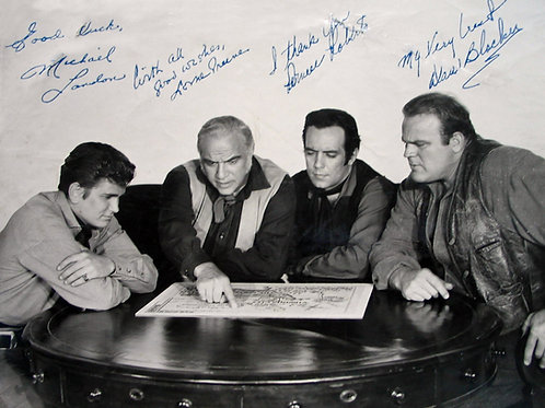 Bast of TV's Bonanza Sitting Around a Table Reading a Map