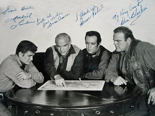 Cast of Bonanza Sitting Around a Table Reading a Map
