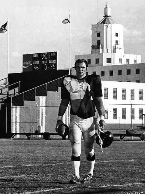 Burt Reynolds as a Football Player in the Longest Yard