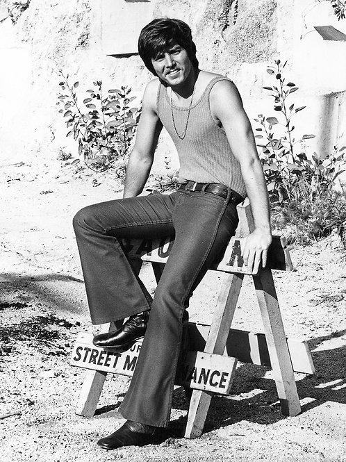 Bobby Sherman Sitting on a Sawhorse