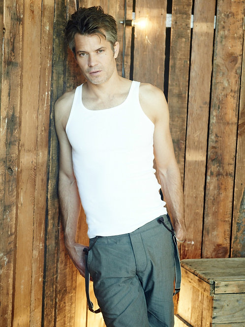 Timothy Olyphant Standing by an Old Crate